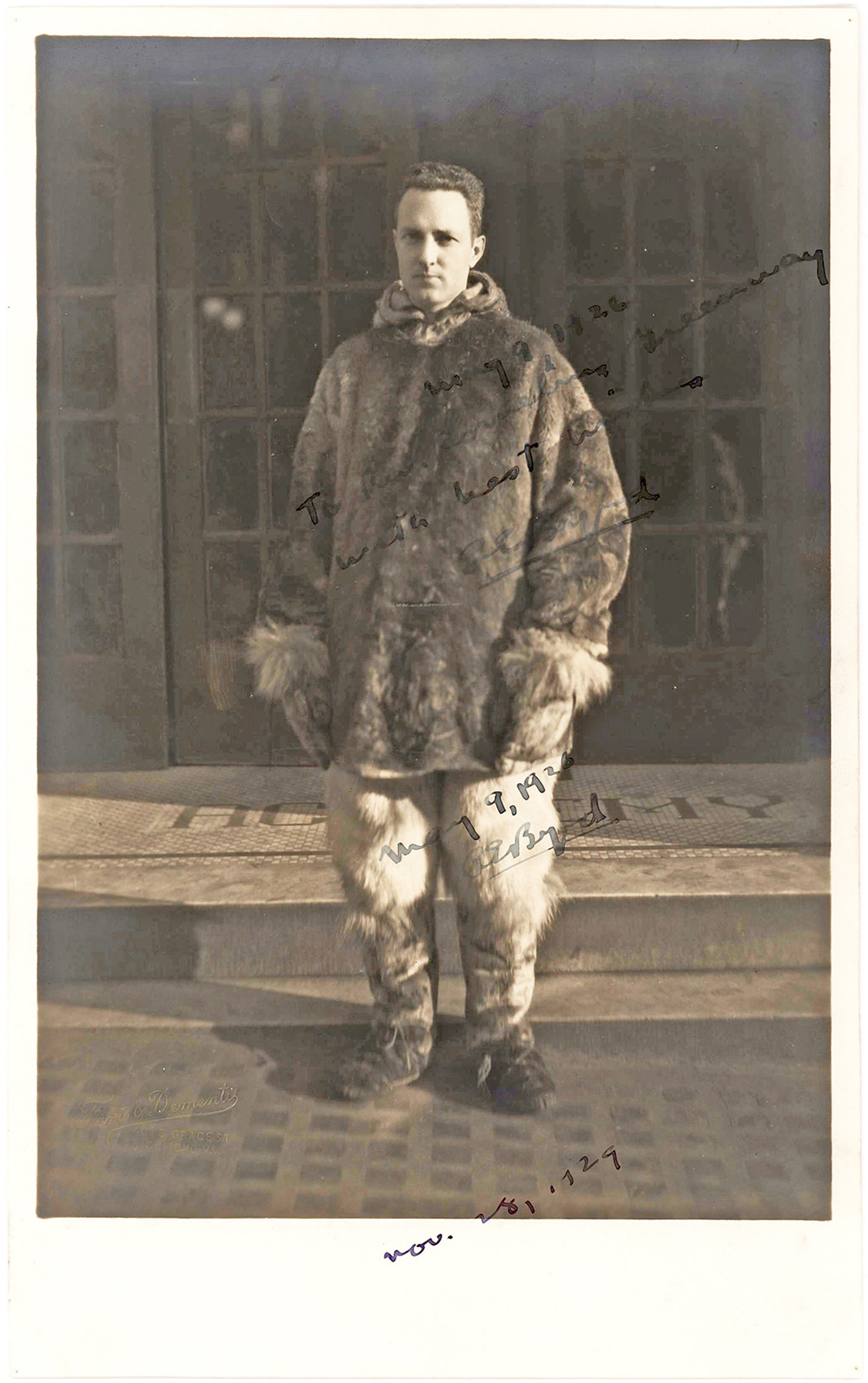Stunning Signed Photograph of Admiral Byrd in Arctic Attire with the Dates of His Groundbreaking Flights Over the North and South Poles