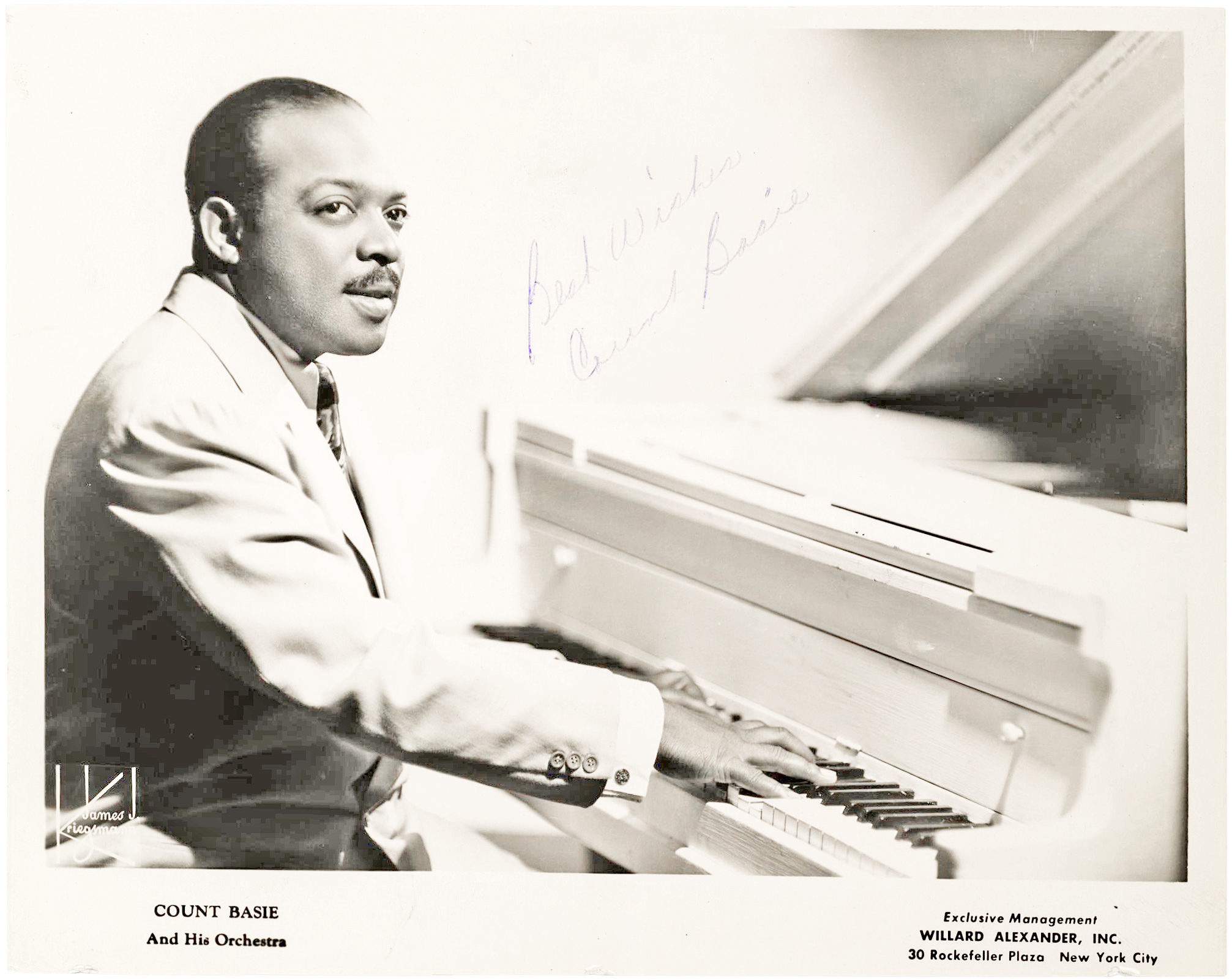 Photograph of Count Basie Seated at His White Piano